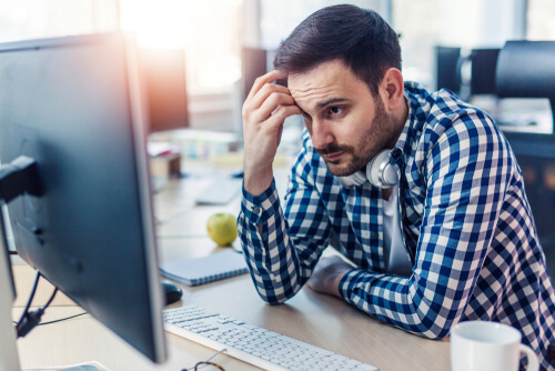 Man staring at computer frustrated
